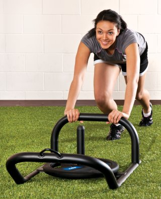 Girl pushing low push/pull sled