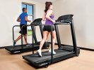 Woman and man running on treadmills