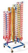 Set of colored jump ropes on storage cart