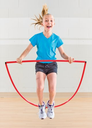 Girl using hoop jumper for exercise