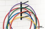 Wall-mount storage rack for hula hoops