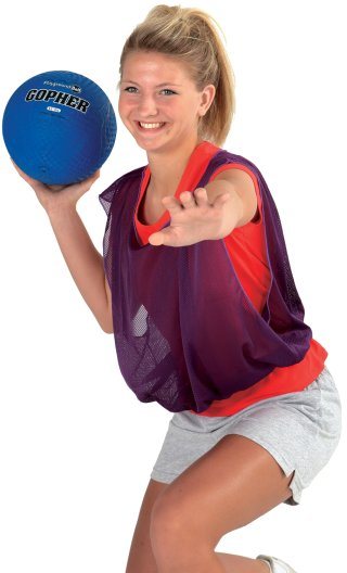 Girl throwing ball while wearing vest