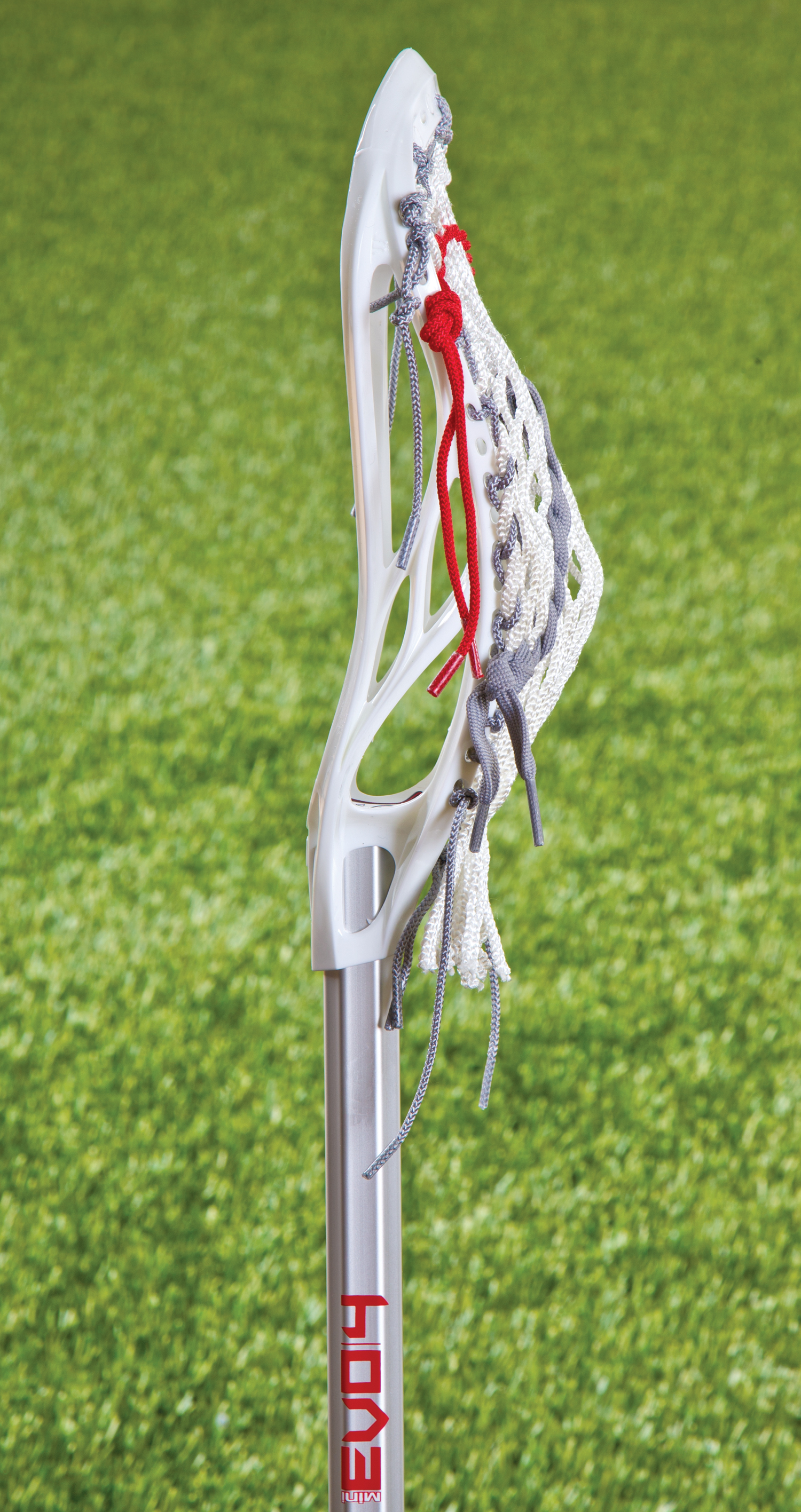 Side view of a mini lacrosse stick