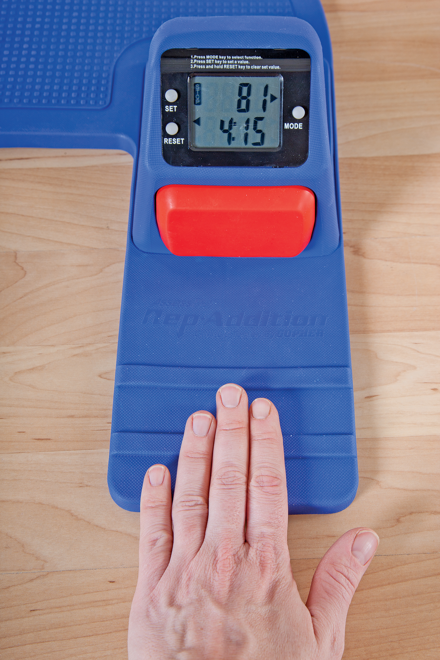 Hand showing counter on testing machine