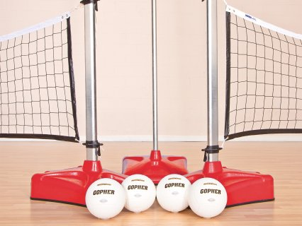 Red standard volleyball net with balls