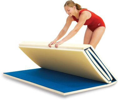 Woman folding carpeted gymnastic mat