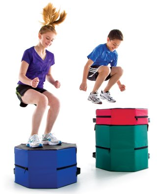 Girl and boy jumping on stackable boxes