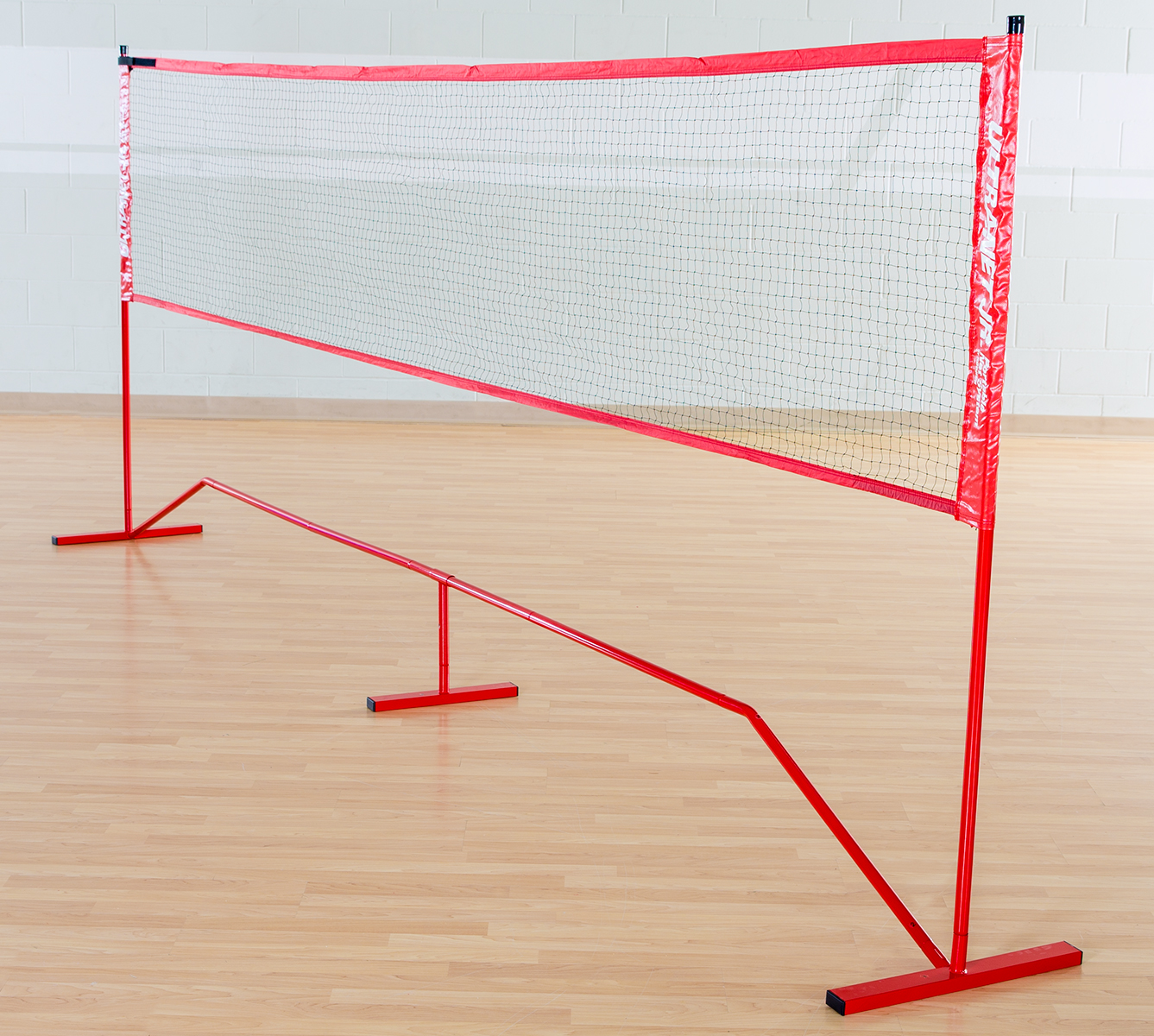 Portable badminton net in gym