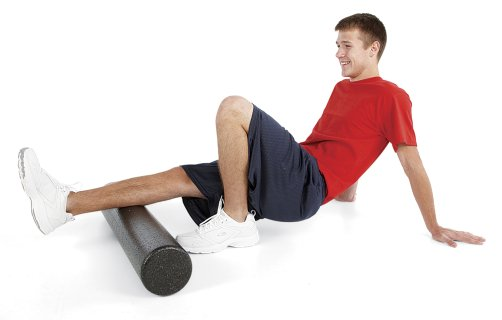 Man stretching leg muscles on foam fitness roller
