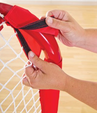 Attaching velcro netting to floor hockey net