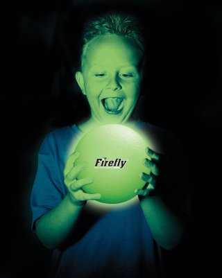 Child holding glow in the dark ball