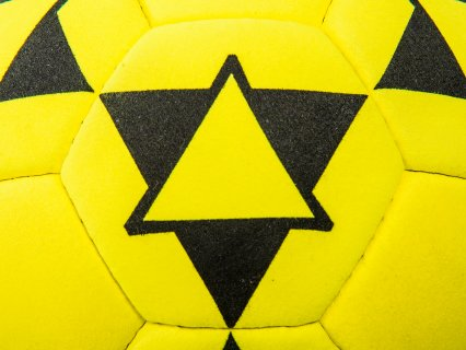 Close up of design on optic yellow soccer ball