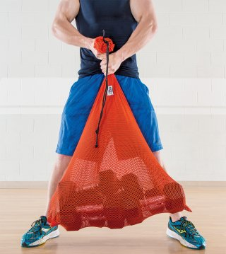 Man lifting heavy storage bag