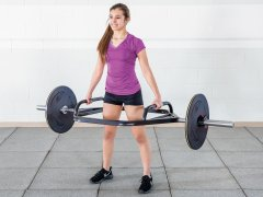 Woman lifting hexagon lightweight lifting bar