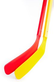 Close up of red and yellow hockey sticks