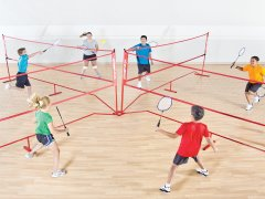 Kids playing 4-way badminton game