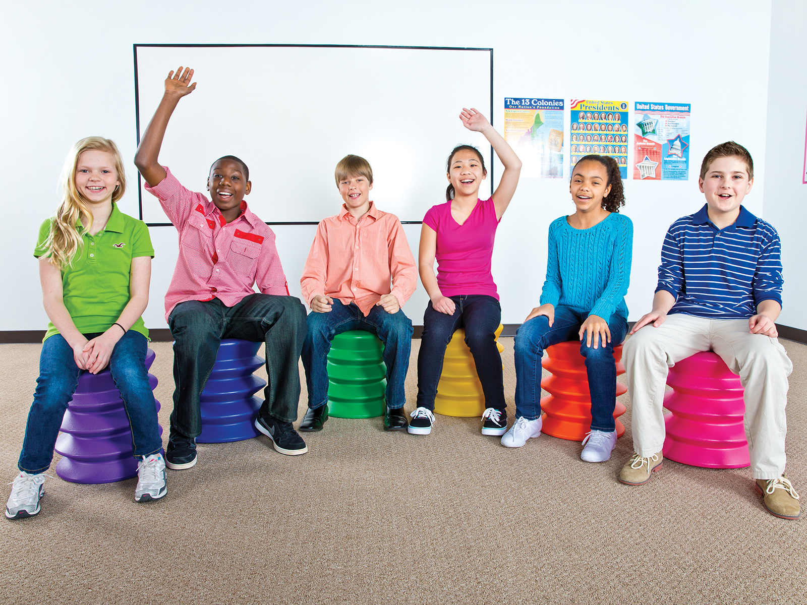 Children on elementary ergonomic seats