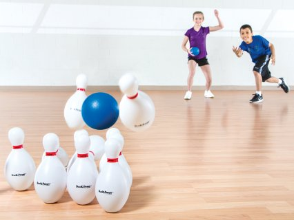 Kids playing duck down bowling game