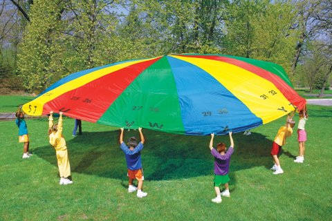 Kids playing with parachute game