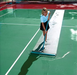 Woman cleaning tennis court