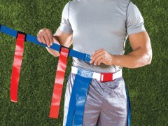 Man holding on to magnetic football flag belts