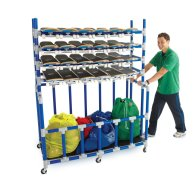 Man rolling storage cart with skateboard equipment
