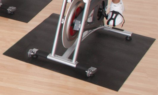 Close up view of equipment mat under stepper machine