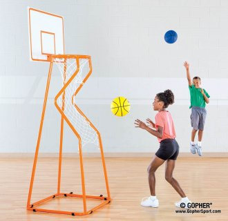 Kids shooting basketballs into net