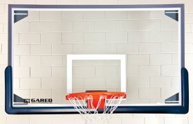 Close up of basketball rim and glass backboard