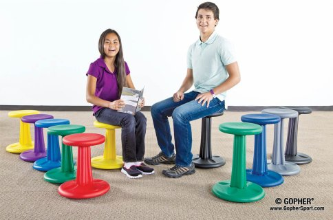Kid and teen sit on wobble chairs