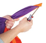 Person with screwdriver trying to rip parachute to show strength
