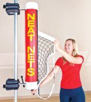 Woman rolling up adjustable volleyball net