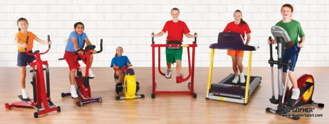 Group of kids using youth cardio machines