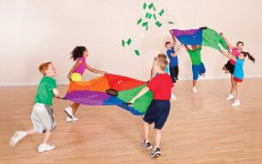 Kids playing nutrition parachute challenge game