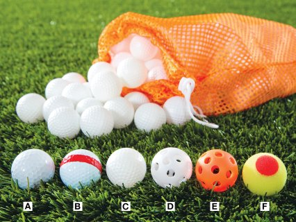 Assorted golf balls and tees